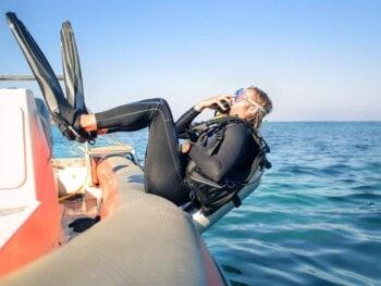 why do scuba divers dive backwards